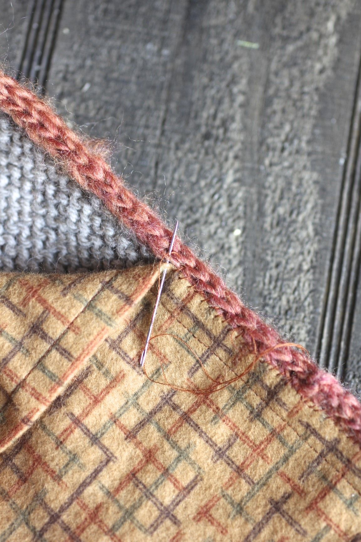 how to actually stitch a fabric back to a knit blanket though it