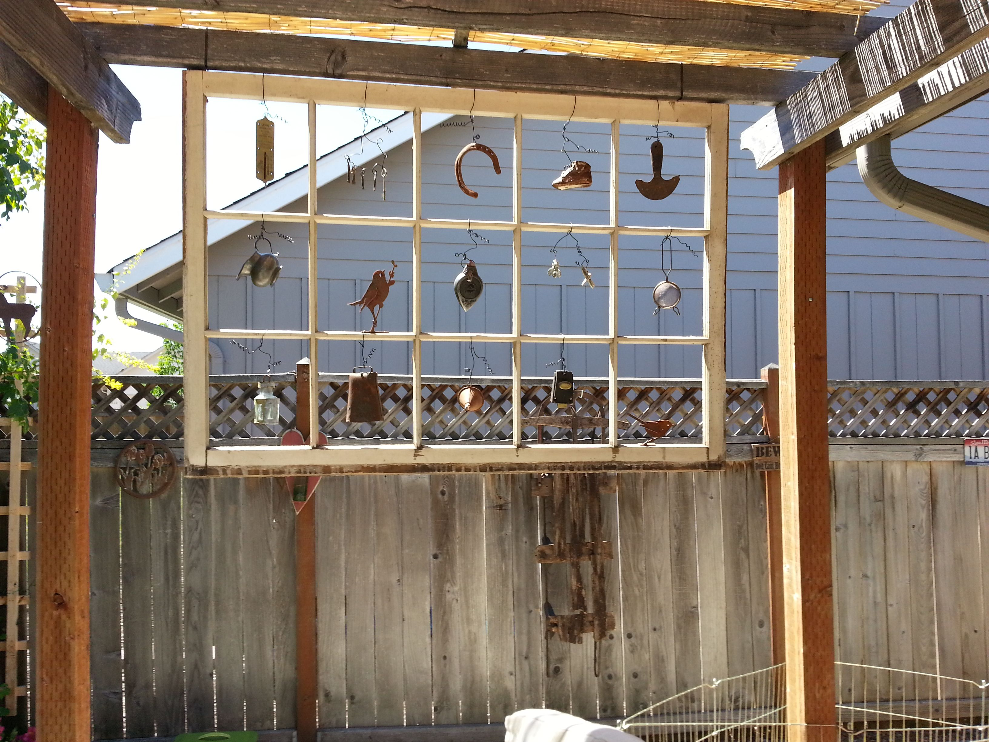 Old barn window (54x37) with old items hung where the glass was ...