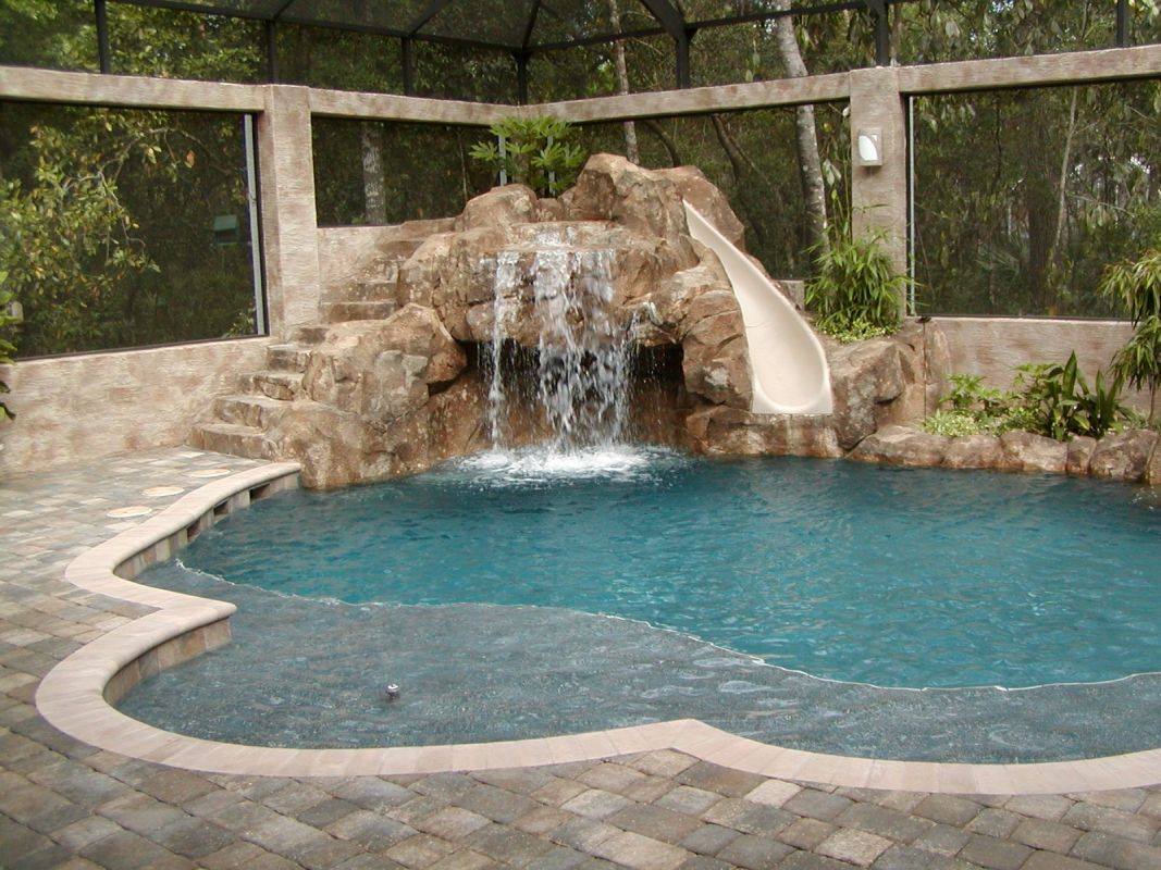 Free form pool with slide all aqua pools rock wall for Pool design examples