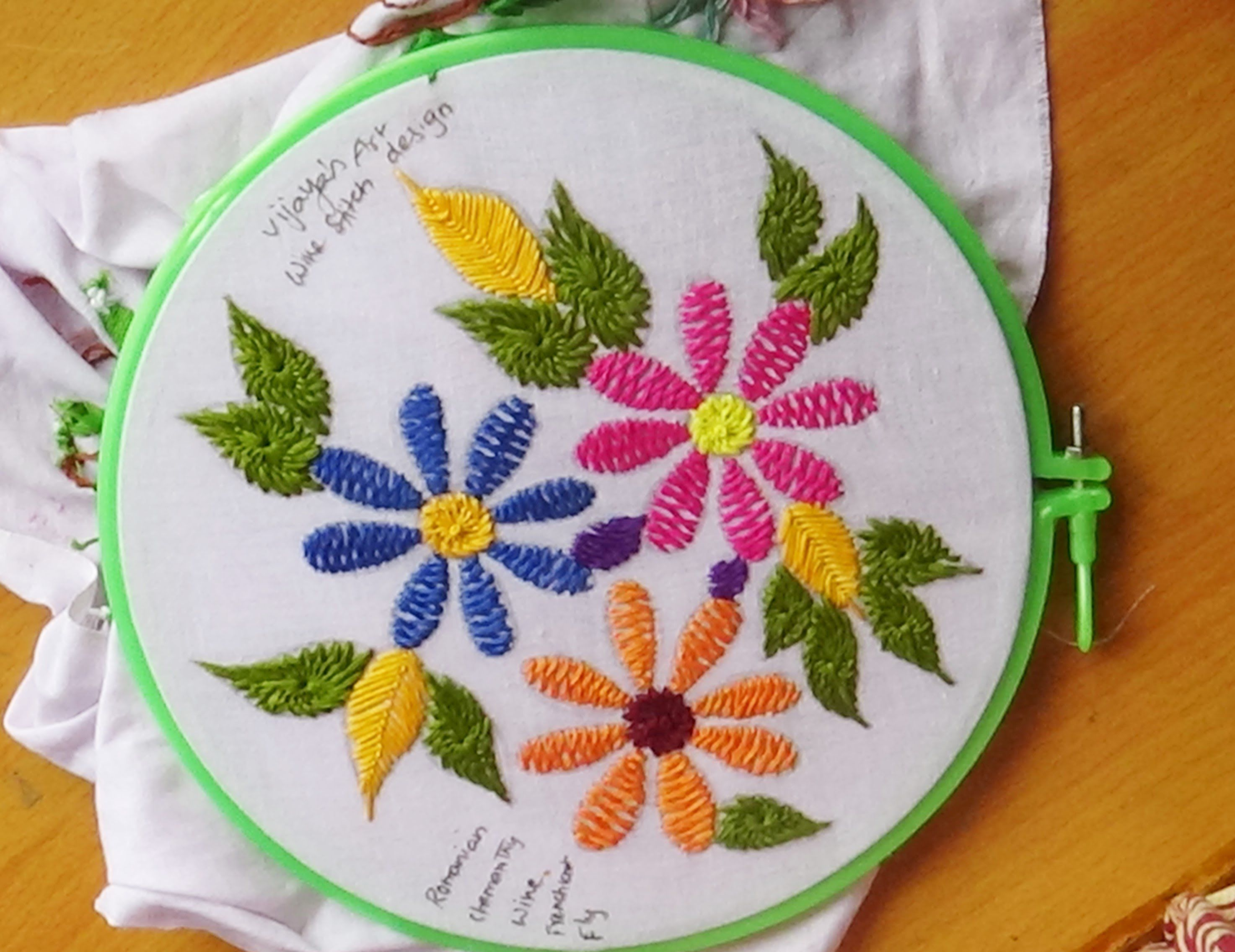 Hand embroidery designs wine stitch flower design