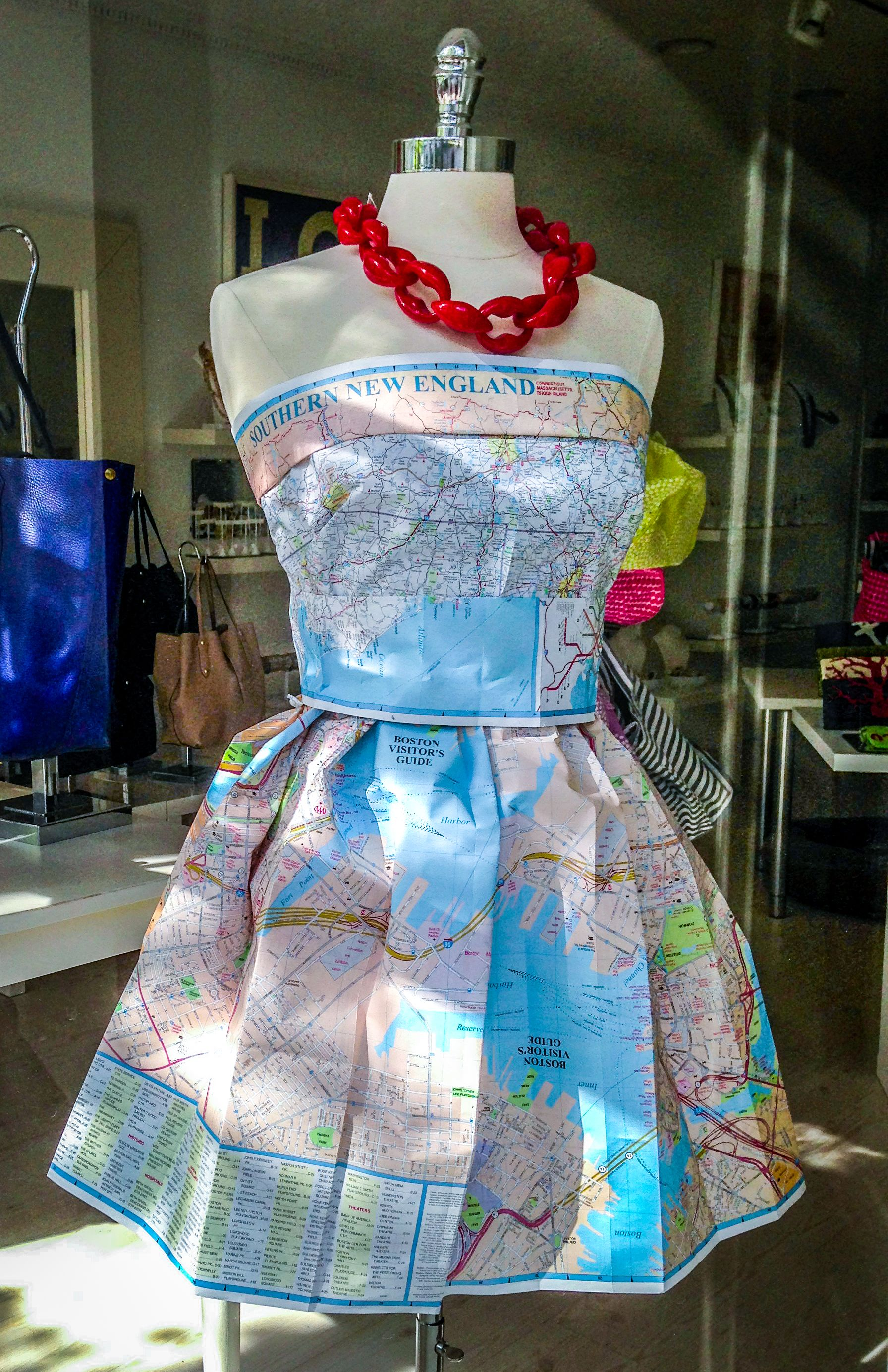 Aaa maps dressing up a store window in nantucket for Anything made by waste material
