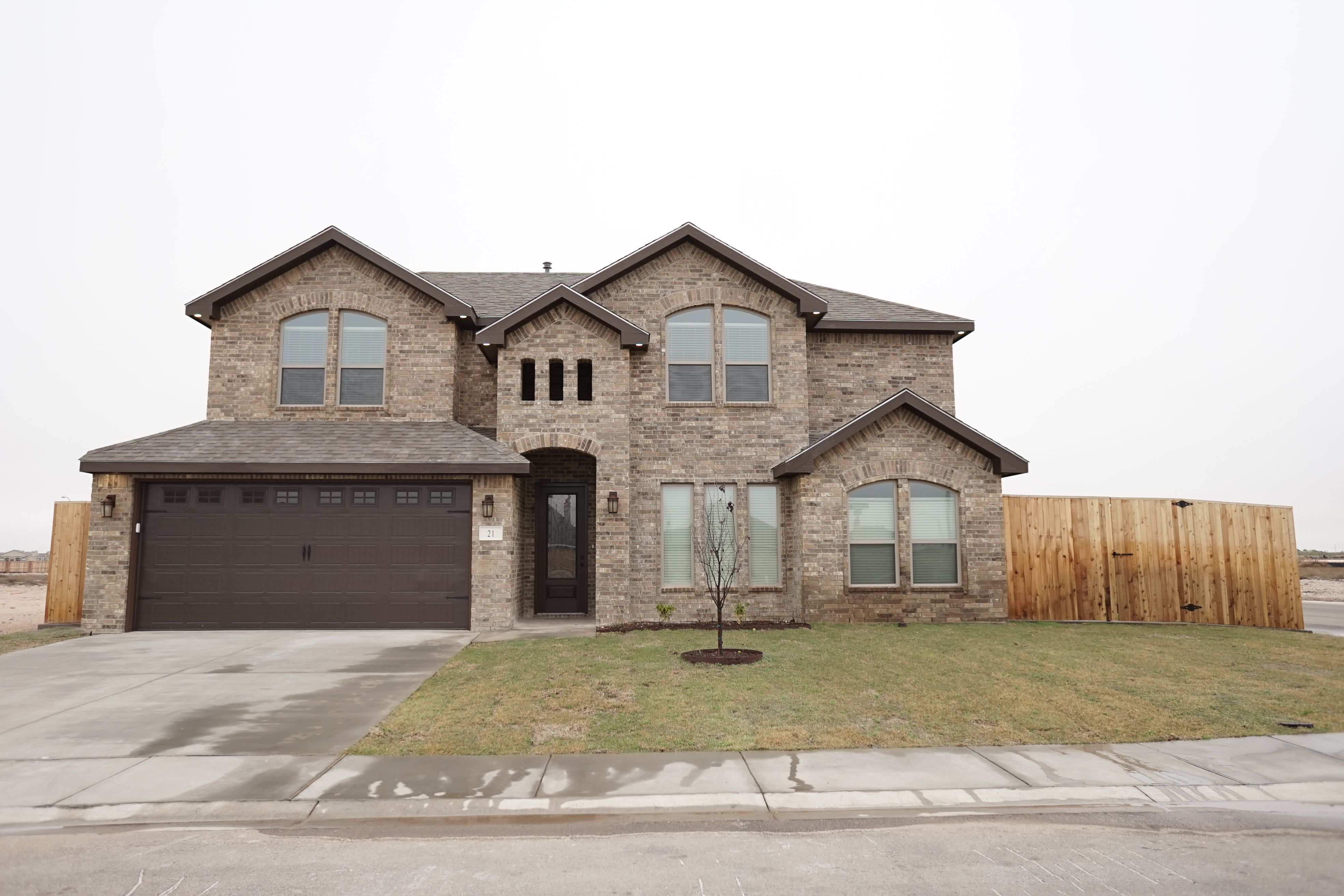 Giana A By Permian Homes Color Sheme E4 French Chateau With Chocolate Trim Garage Door Brick Design House Exterior Model Homes