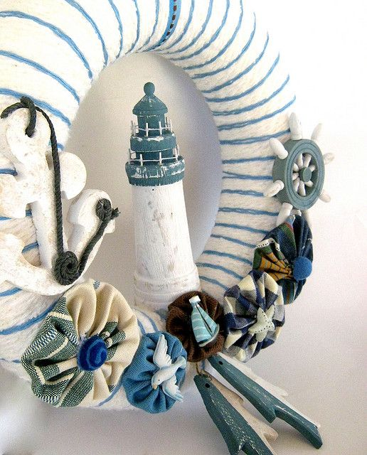 Nautical yarn wreath with lighthouse, anchor and ship wheel.