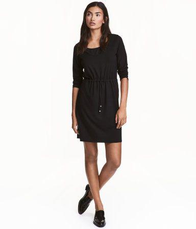 Zwart tricot jurkje lange mouw