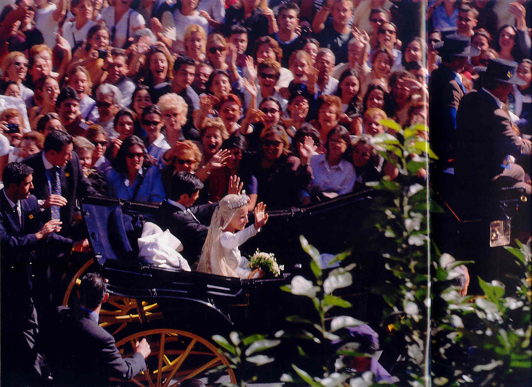 crowds of well-wishers greet the newly weds