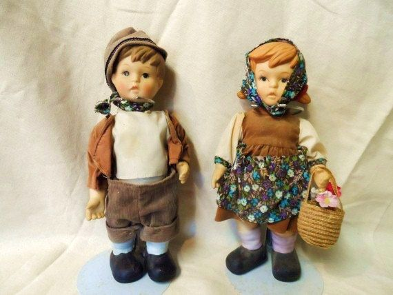 Boy and Girl Porcelain Dolls