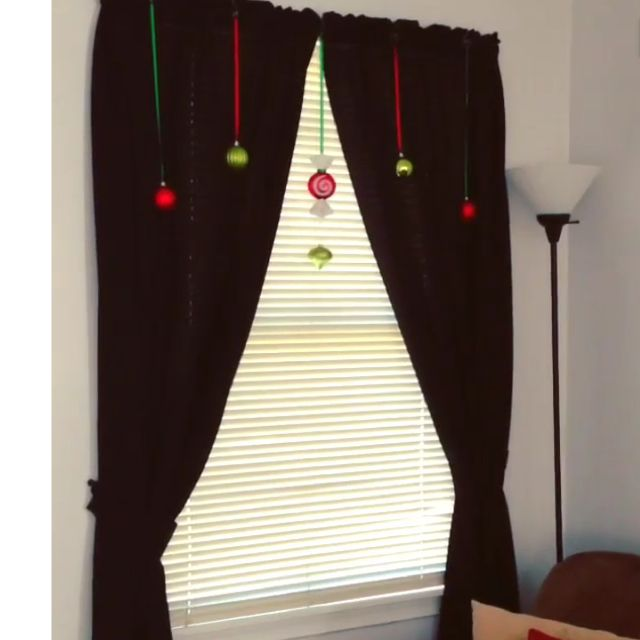 Fun way to decorate windows for Christmas! Place ornaments on string/ribbon and hang by top with a ornament hook