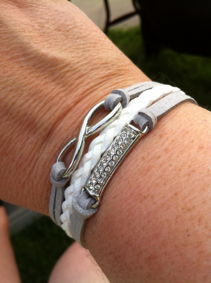 This exclusive, 3-row, grey and white suede bracelet features hints of rhinestones and a polished on-trend infinity design. An adjustable clasp closure.  https://www.facebook.com/JustJewelryByChristine $21