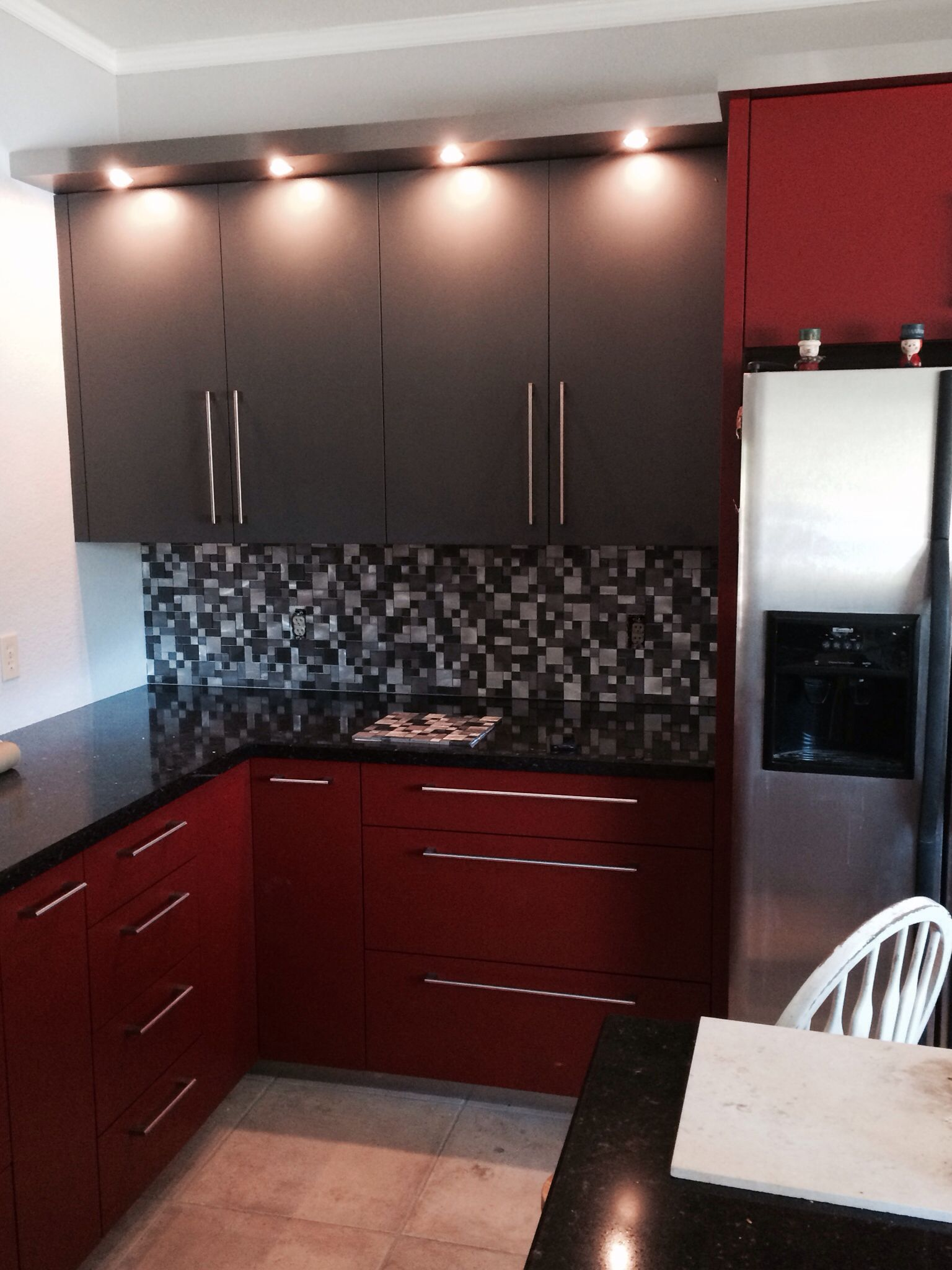 Modern contemporary kitchen in red and gray. Cabinet ...