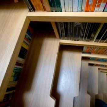 Library Staircase Doubles As Shelving Space For Books [Pics]