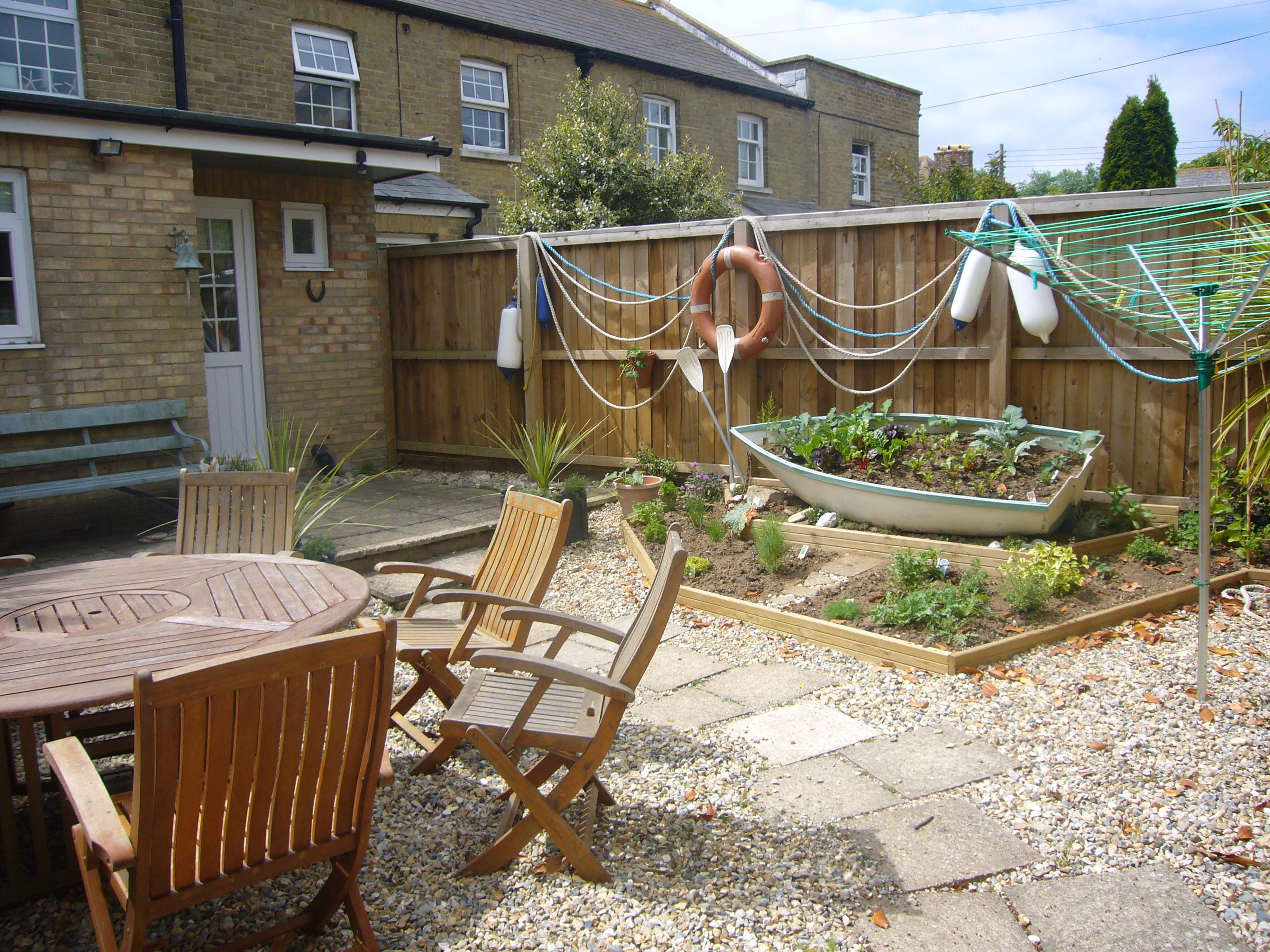 Garden Design Ideas Seaside : Seaside garden using reclaimed and painted boat as a herb