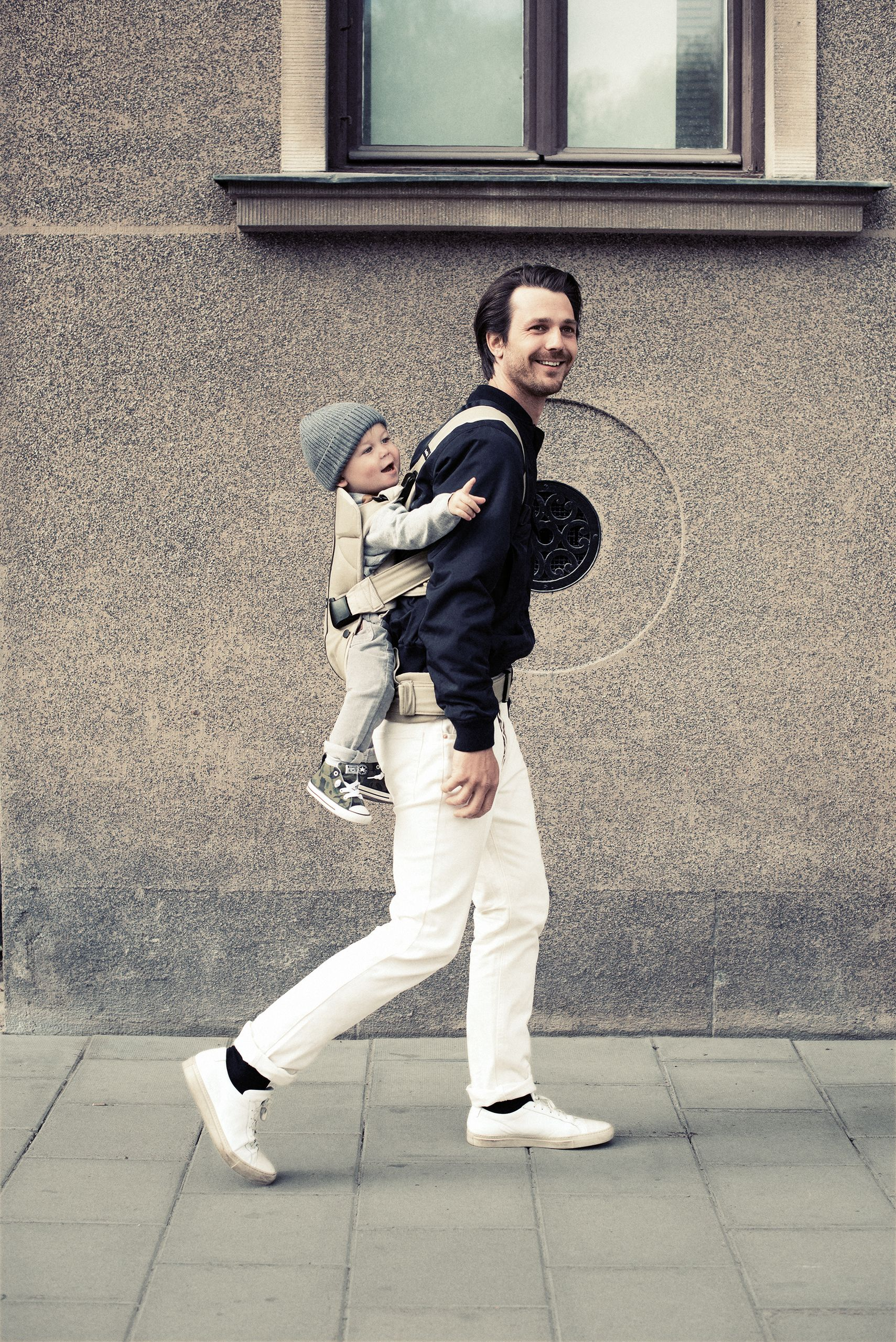 c0f019f2d59 Family in the city. Dad back carrying baby in Baby Carrier One in ...