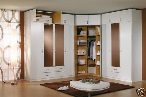 A CORNER built-in wardrobe. Great idea! My taste runs to more of ...