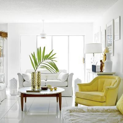 Modern in Miami: the yellow chair breaks up the pristine white palette. Coastalliving.com