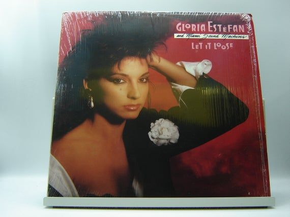 Artist: Gloria Estefan & Miami Sound MachineTitle: Let It Loose Label: Epic OE 40769Year Released: 1987Track Listing: Side 1:Betcha Say ThatLet It LooseCan't Stay Away From YouGive It UpSurrenderSide 2:Rhythm Is Gonna Get YouLove ToyI Want You So Bad1-2-3Anything For YouCondition: Vinyl: NM (9/10) glossy, near perfect condition; minimal surface noise during playback.Cover: VG+ (7/10) in shrink with light ring, edge, and corner wear – no seam splits or writing; small bump on top right corner; ori