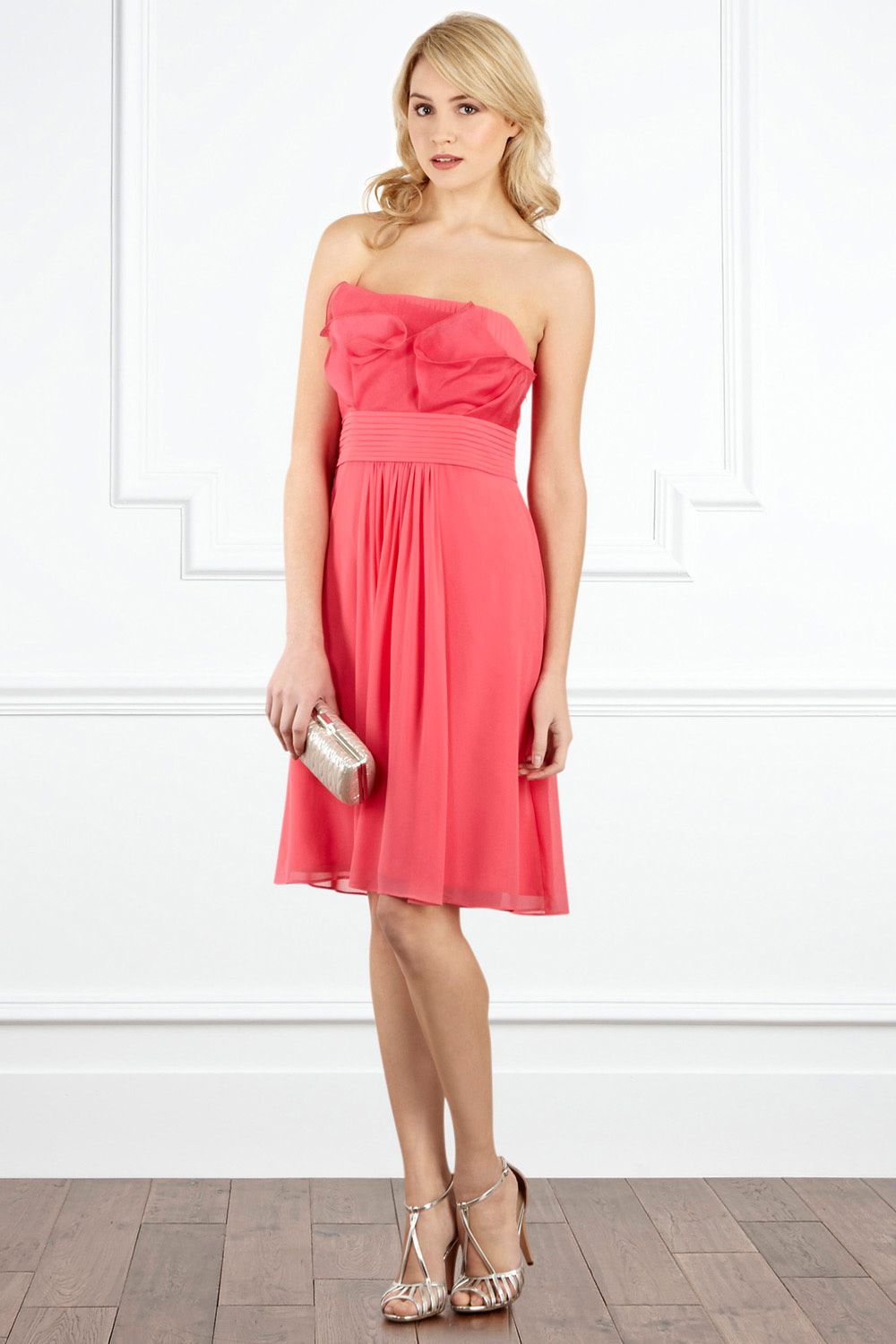 A breathtaking short bandeau dress with structured bust detail the