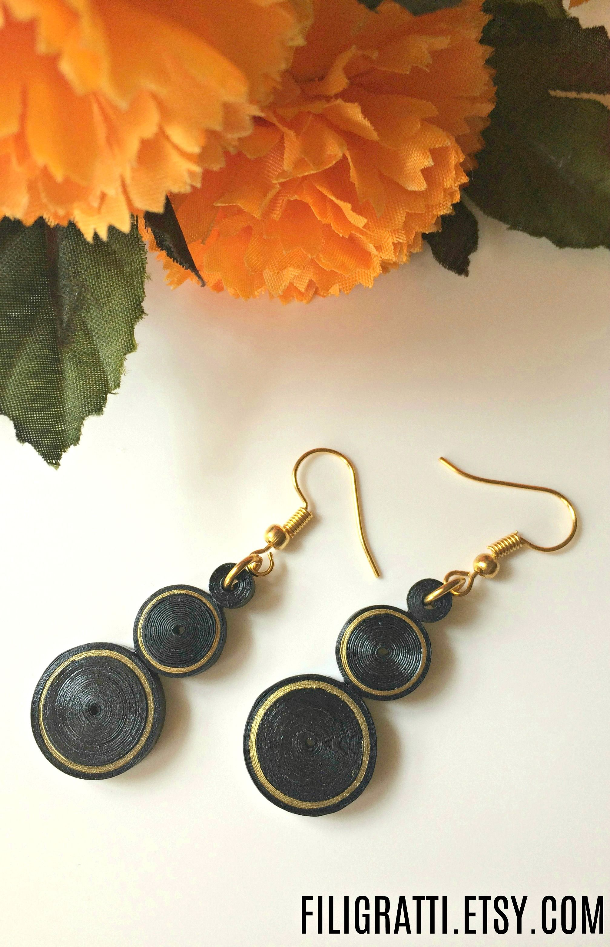 37453d5c2 Simple, Elegant & classy, that's how you'll look when you don these black  dangle earrings with gold accents. They are so light in weight, you won't  even ...