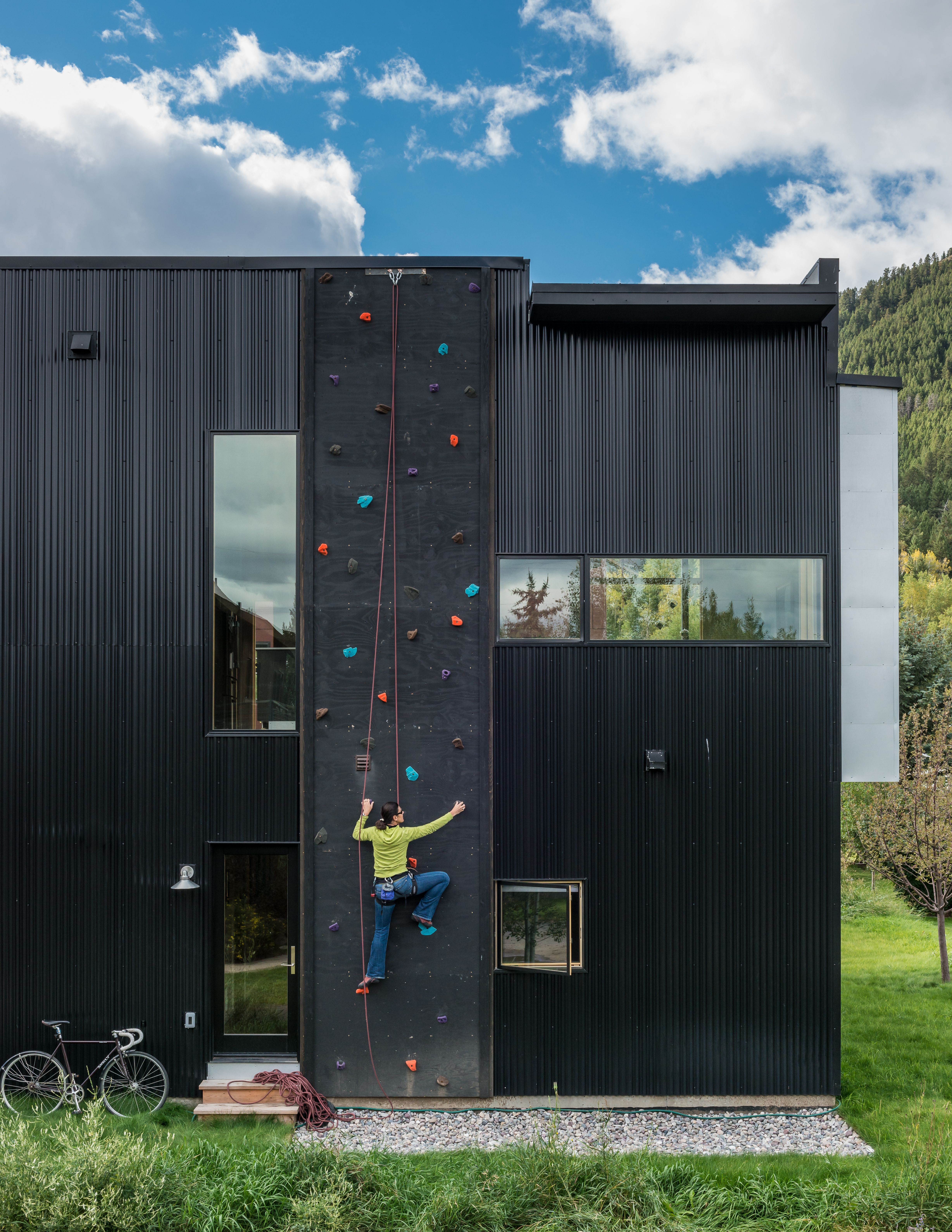 Dotted with colorful footholds a climbing wall covers one side of
