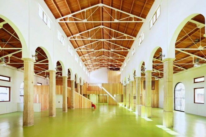 An old market hall converted into a children's centre in Alcañiz, Spain by Barcelona architect duo Miquel Mariné and César Rueda Boné