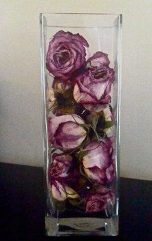 Dried roses displayed in a glass vase. So simple yet