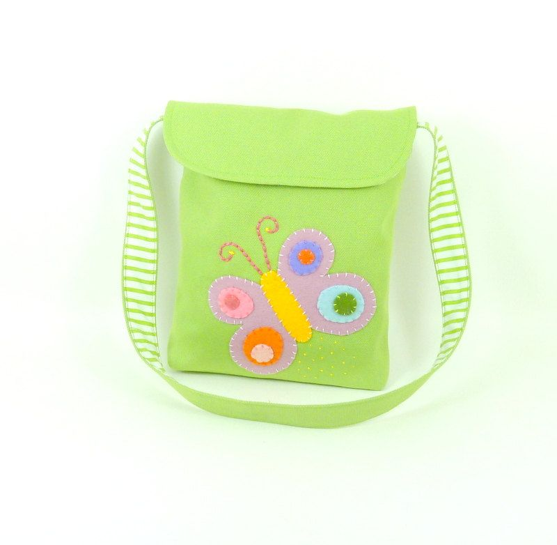 kids messenger bag , organic avocado green cotton duck bag , butterfly applique in purple yellow pink green blue orange. $35.00, via Etsy.