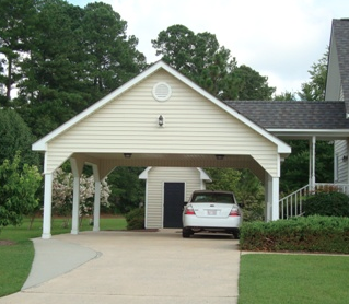 2 car carport with breezeway and railed ramp leading to