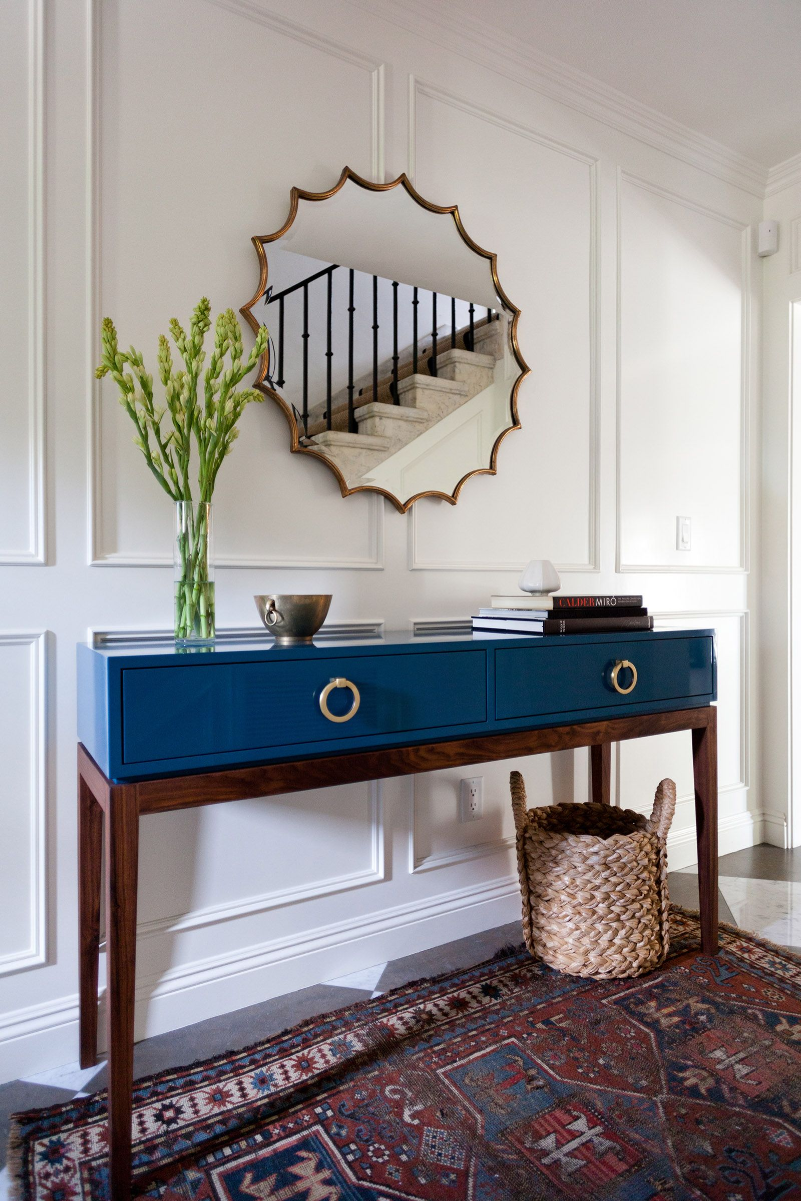 Hallway furniture with mirror  Franklin Hills entry  Taylor Jacobson Interior Design Photo by Amy