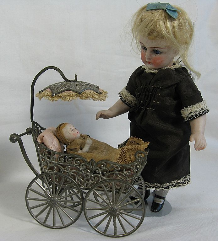 Antique Filigree Doll Buggy/Carriage from fancyandfine on Ruby Lane