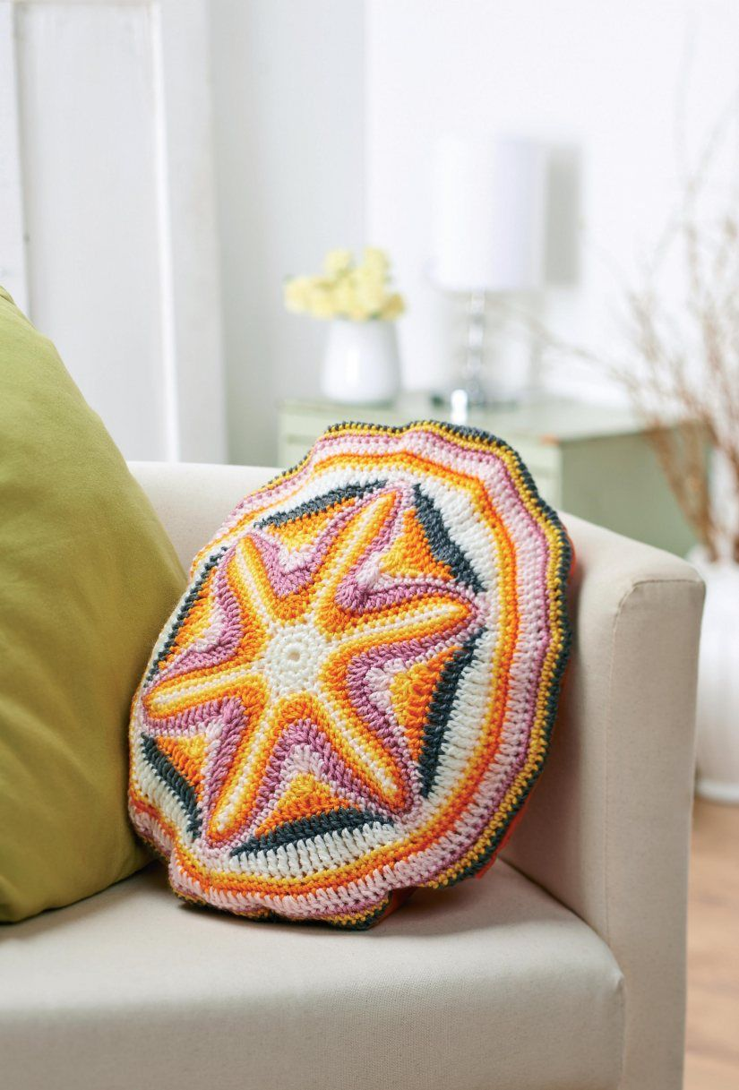 Starburst circle crochet cushion