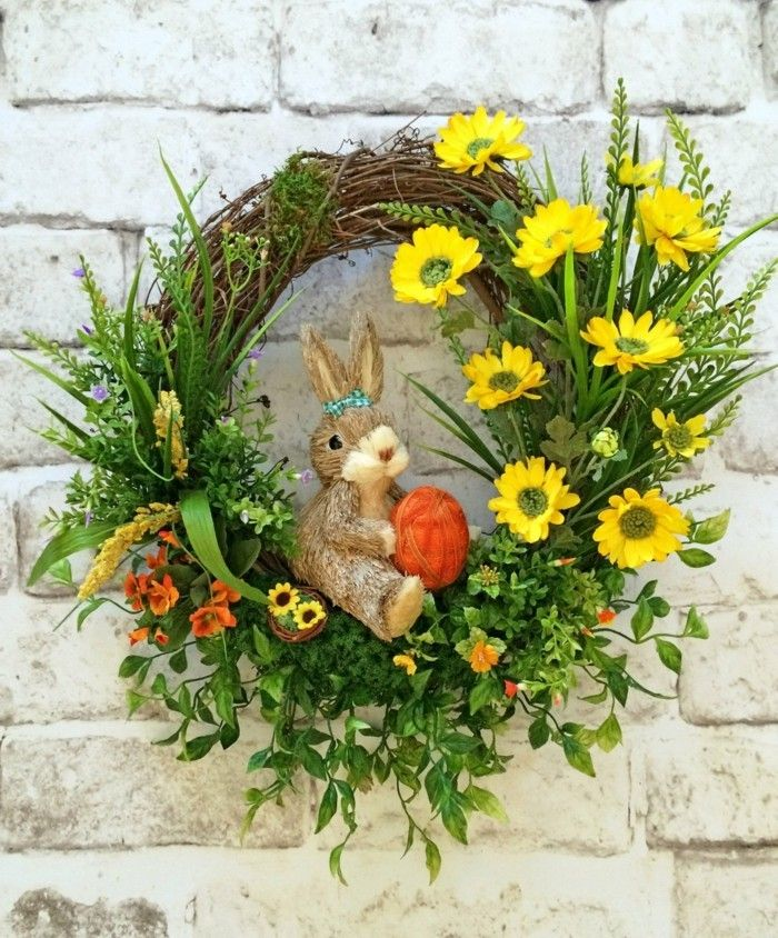 Photo of Easter wreath are made of flowers to greet spring and Easter
