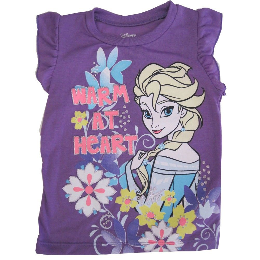 """Cartoon inspired prints are a popular trend for children as shown by this Disney licensed tee. The purple flutter sleeved T-shirt has Frozen character Elsa """"Warm At Heart"""" graphics illustrated with glitter accents. She can pair it with a trendy skirt or p"""