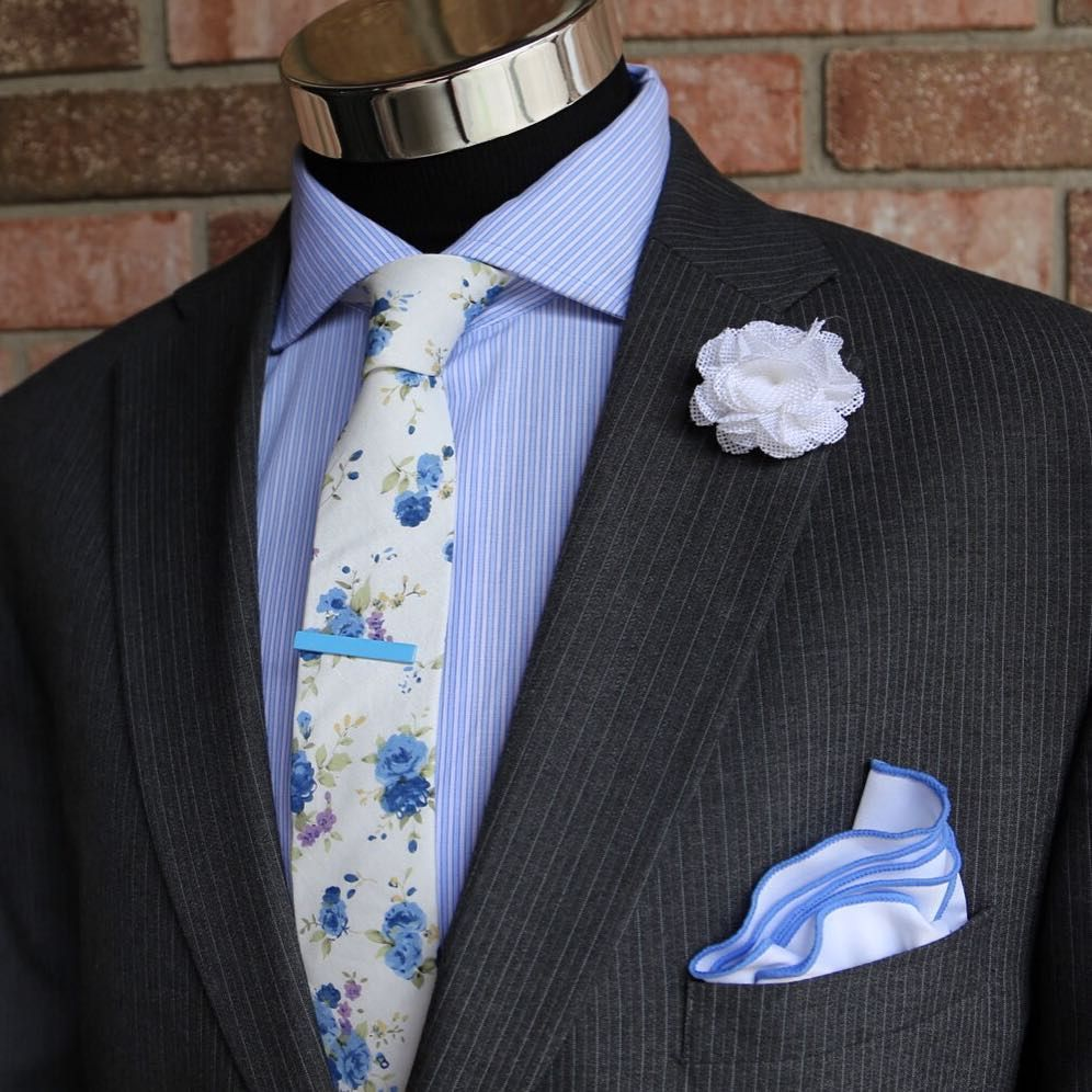 Floral Flow.... ($10) White Burlap lapel pin ($10) White w/ Blue Pocket Round ($14) Blue Tie Clip ($20) Blue Garden Necktie Choose any 3 neckties for $45 Use Code: 3FOR45 Choose any 5 lapel pins for $35 Use Code: 5FOR35 Pocket Rounds/Sq - 3 for $25 Use Code: 3FOR25 Spend over $60 - Get 25% Off Use Code: HBA60 Harrison Blake Apparel www.harrisonblakeapparel.com Join Our Monthly Club