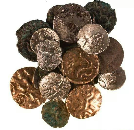 # A HORD OF ROMAN AND LATE IRON AGE COINS HAS BEEN DISCOVERED IN  A CAVE IN ENGLAND.