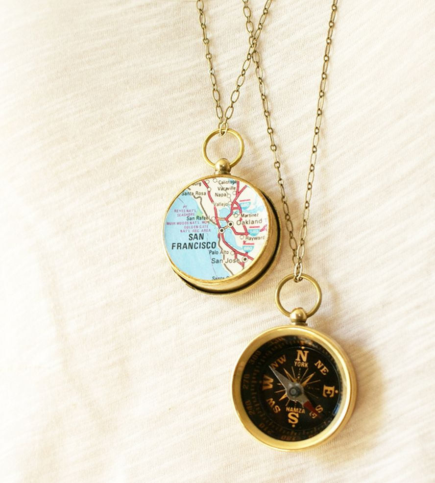 necklace pin and map compass