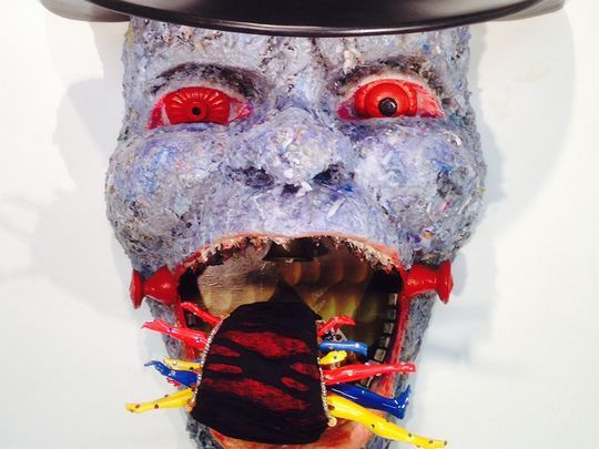 """Suprina Kenney, """"Tipping Point--4th Stage of Capitalism,"""" sculpture composed from wax, foam, street trash, doll parts, wood, fabric, detritus, paper, epoxy and paint (Photo: ~Courtesy of Suprina Kenney)"""