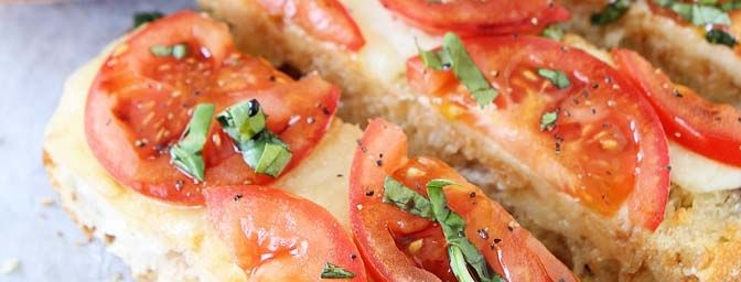 Try a fun twist on a classic Italian dish with this Caprese Garlic Bread recipe! It makes for a great appetizer to any one of our meals! #recipe #Italian