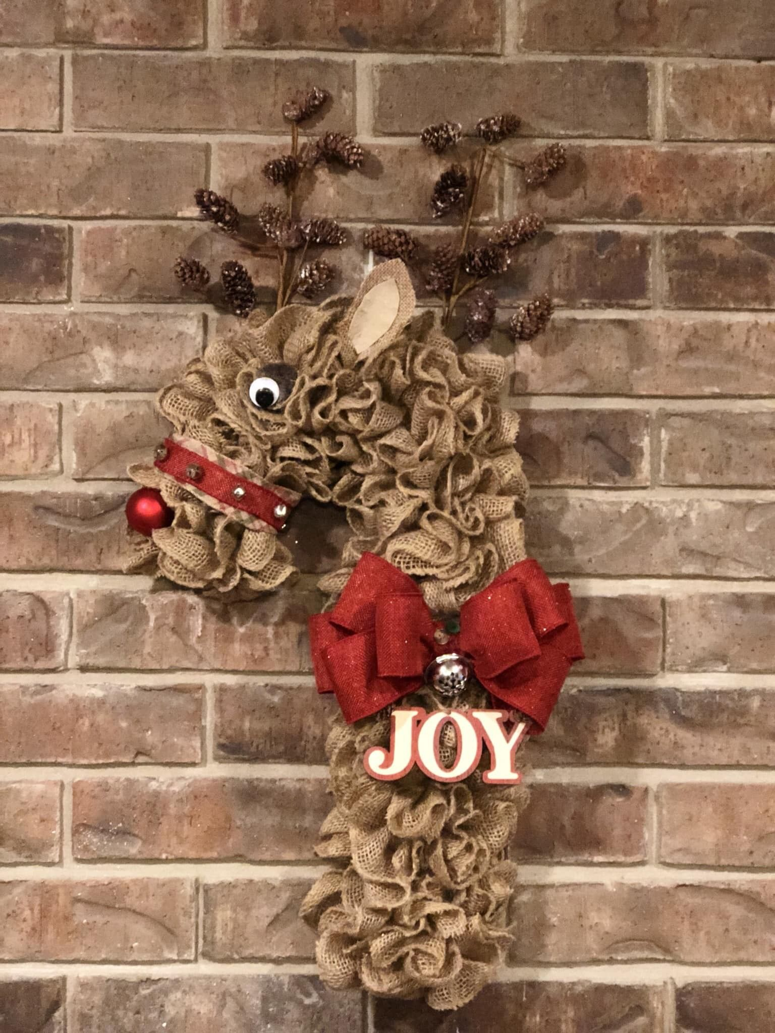 My try at the Reindeer candy cane wreath! #reindeerwreath #wreath #Christmaswreath #candycanewreath