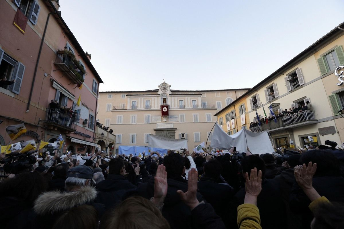 Pope Benedict XVI greets faithful from his summer residence of Castel Gandolfo, the scenic town where Pope Benedict XVI will spend his first post-Vatican days and made his last public blessing as pope,Thursday, Feb. 28, 2013. (AP Photo/Luca Bruno)