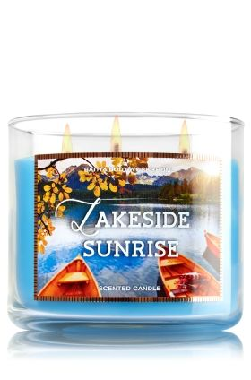 """Lakeside Sunrise - 3-Wick Candle - Bath & Body Works - The Perfect 3-Wick Candle! Made using the highest concentration of fragrance oils, an exclusive blend of vegetable wax and wicks that won't burn out, our candles melt consistently & evenly, radiating enough fragrance to fill an entire room. Topped with a decorative fall lid! Burns approximately 25 - 45 hours and measures 4"""" wide x 3 1/2"""" tall."""