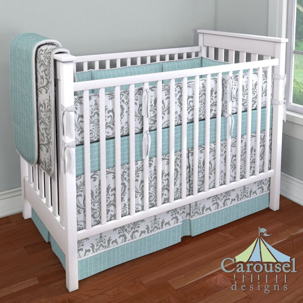 Crib bedding in Aqua Herringbone, Gray Traditions Damask. Created using the Nursery Designer® by Carousel Designs where you mix and match from hundreds of fabrics to create your own unique baby bedding. #carouseldesigns