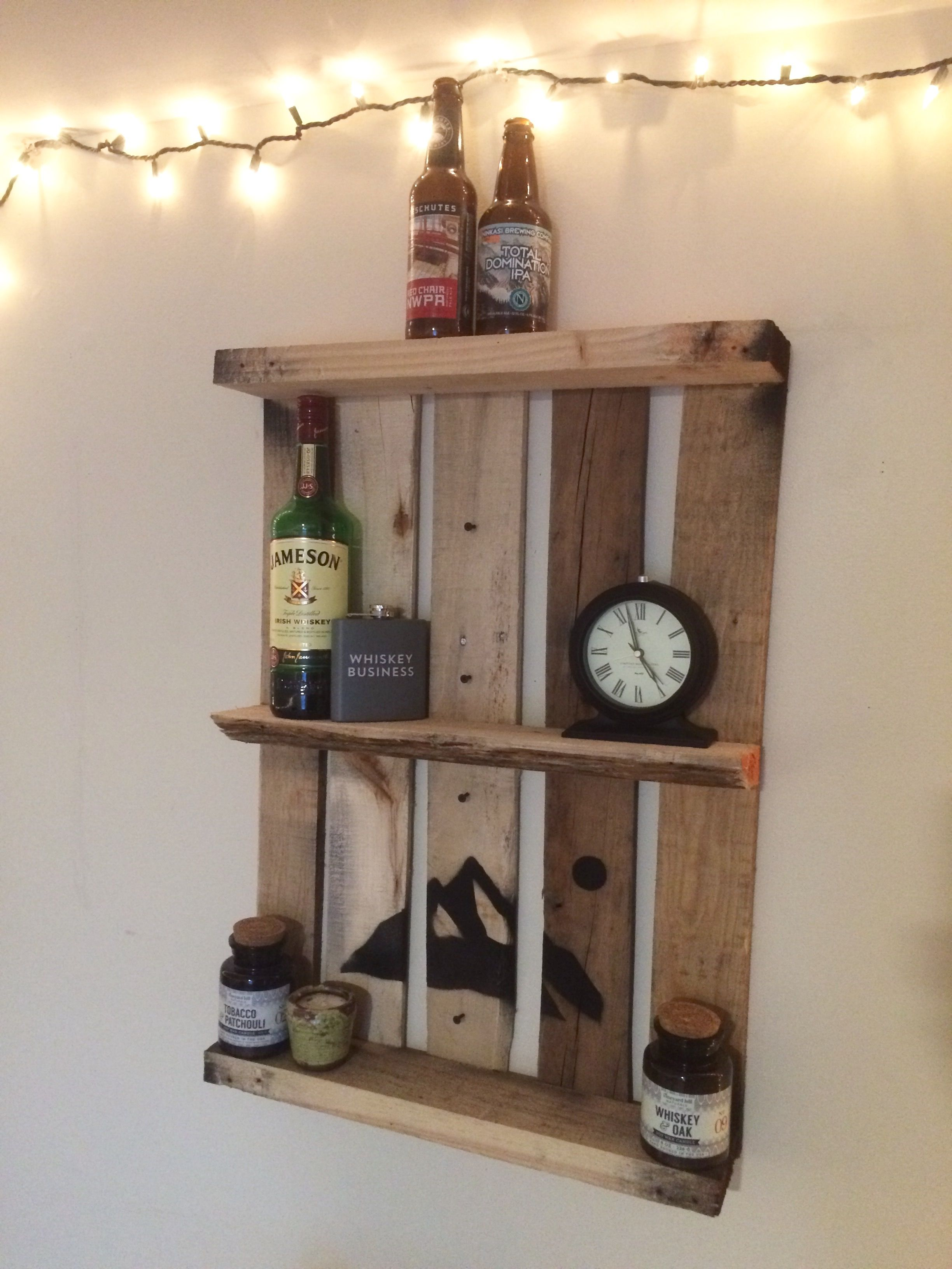 Easy. Used small pallet, removed two long planks, spray painted a stencil, screwed it into wall studs. Instant shelf. #shelf #shelving #interior #decor #diy #palletfurniture