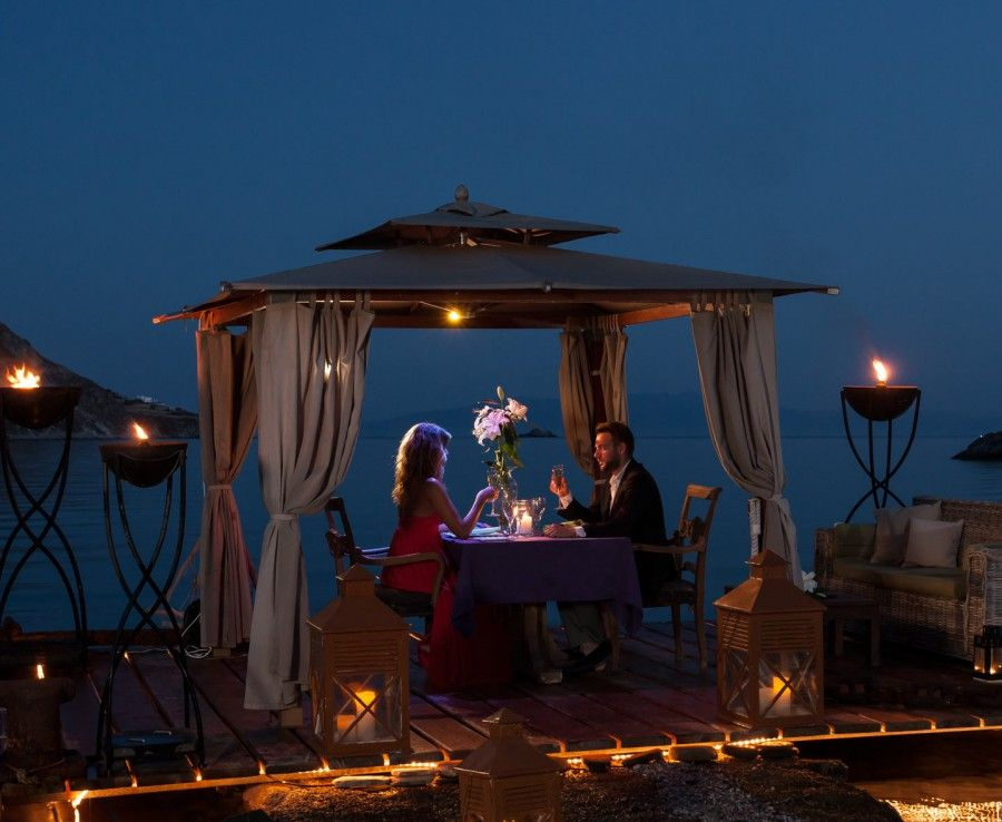 Private candlelight beach dining for a couple at the for Boutique hotels for couples