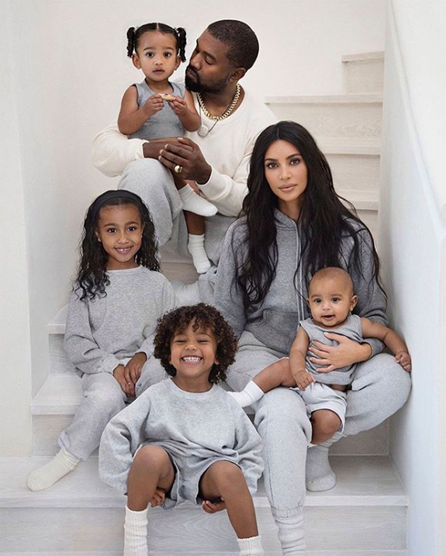 Kim Kardashian and Kanye West with their children