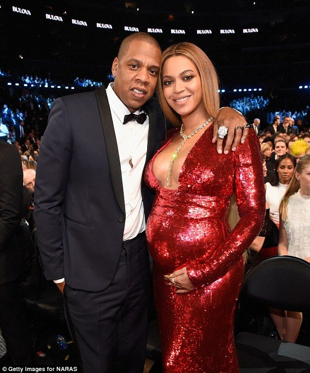 So in love: Jay and Bey looked smitten as ever while posing together near their seats at t...