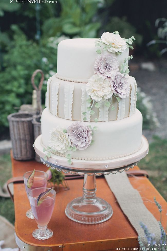 A neutral wedding cake with soft pastel pops of color.