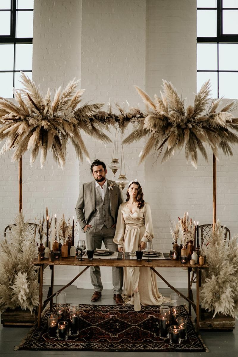 Sweetheart Table Decorated with Pampas Grass installation