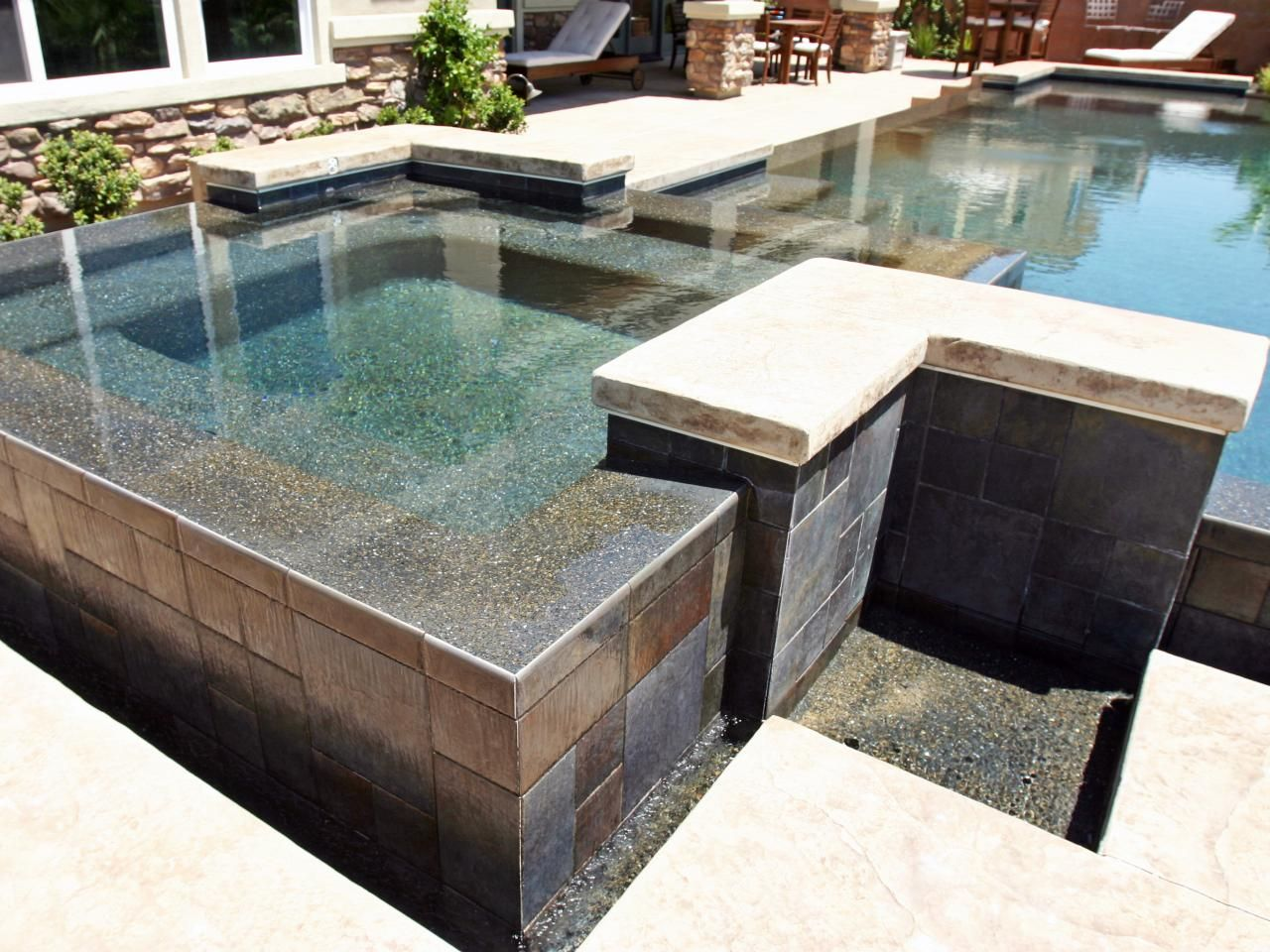 This lovely backyard pool and spa utilizes sharp geometric shapes ...