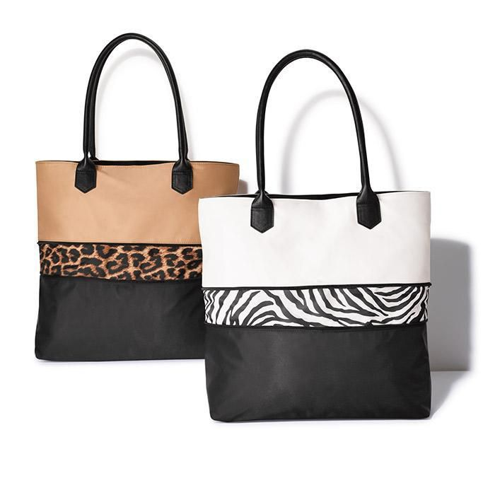 Pop of Animal Print Expandable Tote. Just undo the zipper  to reveal a cute animal print and the tote expands| Avon