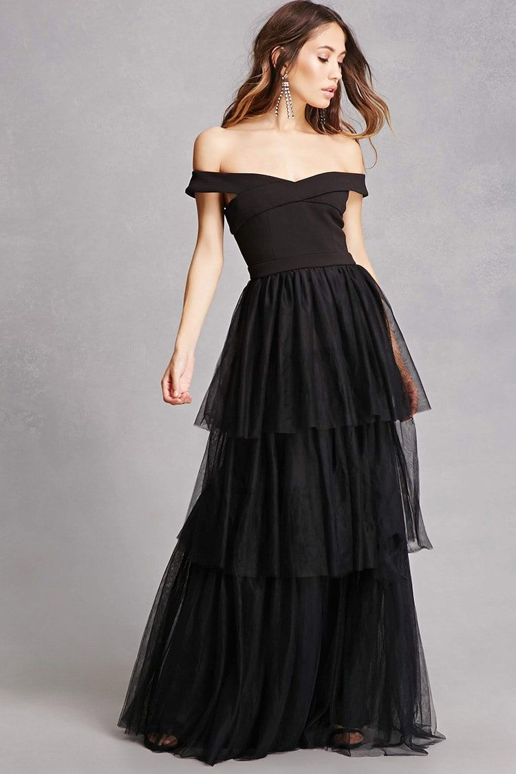 A woven evening gown featuring an offtheshoulder design a v