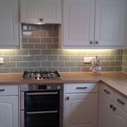 Cream Kitchen With Oak Worktops And Green Metro Tiles Trendy Kitchen Tile Light Wood Kitchens Kitchen Tiles
